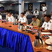 U.S. and Philippine navy delegation members pray the commencement of staff talks aboard USS Blue Ridge