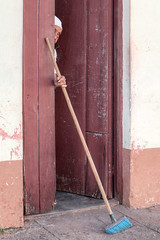 The lady and the broom (FX-1988) Tags: broom lady old trinidad portrait street cuba latino america urban door clean shy home holding pick eyes face hidden