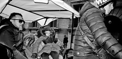 """Stop saying """" I'm cold daddy"""" your here to enjoy yourselves!!! (Baz 120) Tags: candid candidstreet candidportrait city contrast street streetphotography streetphoto streetcandid streetportrait strangers rome roma ricohgrii europe women monochrome monotone mono noiretblanc bw blackandwhite urban life portrait people italy italia grittystreetphotography faces decisivemoment"""