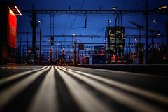 Zurich Main Station - Switzerland (Patrik S.) Tags: zürich kantonzürich schweiz ch train main station tracks signals red blue hour citry skyline cable white lines sony alpha a7m3 a7iii ngc sbb dusk dawn sky die mobiliar platform cff ffs zurich switzerland