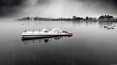 Lost summer (andreasbrink) Tags: italy lagodimonate landscape winter snow boat abstract zeissmilvus