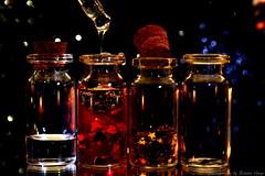 Love Potion (Ronnie Gaye) Tags: flickrfriday love potion bottles alchemy drops bokeh hearts stars