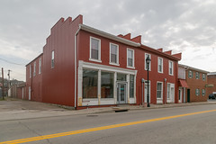 Building — Ripley, Ohio (Pythaglio) Tags: building structure ripley ohio unitedstatesofamerica us historic twostory altered steppedgable parapeted 11windows storefront brick metal cladding sidewalk street browncounty clouds sills