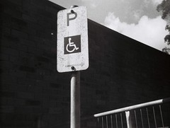 Disabled parking sign (Matthew Paul Argall) Tags: ansco50 fixedfocus 110 110film subminiaturefilm lomographyfilm 100isofilm blackandwhite blackandwhitefilm sign disabledparking