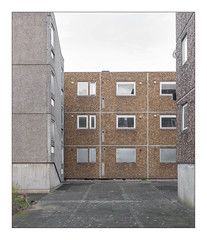 The Built Environment, South East London, England. (Joseph O'Malley64) Tags: thebuiltenvironment newtopography newtopographics manmadeenvironment manmadestructures buildingsstructures buildings structures abandonedhousingestate housingestate councilestate abandonedbuildings derelict dereliction awaitingdemolition demolition derelictbuildings urban urbanlandscape housing homes dwellings abodes architecture architecturalfeatures architecturalphotography socialdocumentary documentaryphotography britishdocumentaryphotography southeastlondon london england uk britain british greatbritain steelreinforcedconcretestructures prefabricatedconcretepanels reinforcedconcretestructures concretestructures concrete texturedconcrete pebbles flints flues windows doubleglazedwindows doubleglazing upvcdoubleglazing metalplates blockedupwindows satellitedish lamp lighting paving pavement tarmac brickpaving weeds lichen shapes geometricshapes rectangles fujix fujix100t accuracyprecision