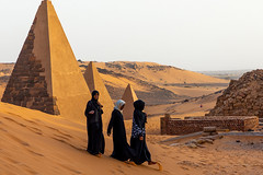 Sudanese women visiting the pyramids of the kushite rulers at Meroe, Northern State, Meroe, Sudan (Eric Lafforgue) Tags: adultsonly africa ancient ancientcivilization archaeology architecture blackpharaohs cemetery colorimage copyspace day desert famousplace fulllenght horizontal mausoleum meroe meroitic northsudan northerncemetery nubia outdoors photography placeofburial pyramid reconstructed saharadesert sudan sudan180908 thepast threepeople tomb tourism tourists tranquilscene travel traveldestinations unescoworldheritagesite unrecognisablepeople women womenonly northernstate sd