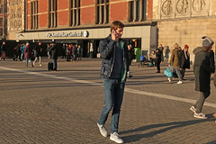 Stationsplein - Amsterdam (Netherlands) (Meteorry) Tags: europe nederland netherlands holland paysbas noordholland amsterdam amsterdampeople candid streetscene people centrum centre center stationsplein centraalstation guy male boy teen twink man happiness smile winter hiver sneakers trainers baskets skets nike smartphone mobile january 2019 meteorry
