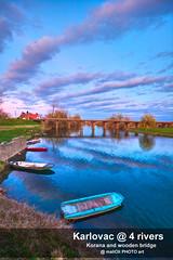 Korana and wooden bridge (malioli) Tags: boat river water bridge sky clouds reflection korana karlovac croatia canon hrvatska europe wooden
