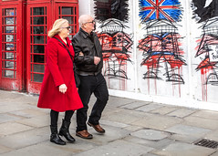 Town Already Painted Red (DobingDesign) Tags: streetphotography red people londoners redcoat colourpop streetart hoarding londontelephonebox iconic unionjack streets couple together colour saturated nathanbowenartist nathanbowenartwork design admiration admiring candid darkglasses strolling arminarm messy phonebox curious