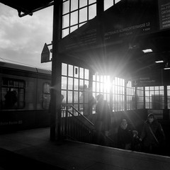 Riding Home (ucn) Tags: berlin friedrichstrasse rolleiflex35b mutar07x berggerpancro400 sbahnhof street backlight gegenlicht filmdev:recipe=11717 adoxadoluxatm49 developer:brand=adox developer:name=adoxadoluxatm49