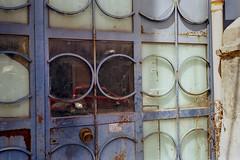 Red car garage (ADMurr) Tags: naples napoli italy italia iron glass door red car c leica m6 kodak ektar dab4102