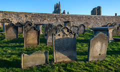 Whitby, gravestones and abbey (alh1) Tags: northyorkshire stmaryschurch england whitby