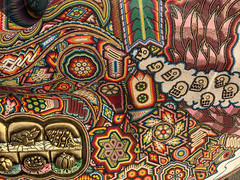 huichol texture 4 (ikarusmedia) Tags: texture patterns huichol waxarika skull sculpture detail closeup reforma avenue mexico city exposition star glyphs aztec mexica skulls pumpkin rabbit cacti feathers