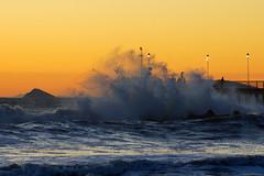 Mare mosso a Marina di Massa (Darea62) Tags: sea sunset waves water nature tramonto seascape bridge pier jetty streetlights tuscany toscana italy foam island rough