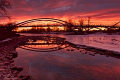 Finest Sunrise I witnessed for awhile! (John Andersen (JPAndersen images)) Tags: bowriver bridge calgary city clouds morning park sculpture sunrise towers train