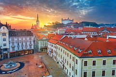 Bratislava. (Rudi1976) Tags: bratislava slovakia city architecture skyline cityscape aerial castle travel twilight sky outdoor exterior town capital traveldestination tourism riverside townsquare dusk urban europe sunset fountain tower europeanunion clouds downtown colorful church famous hotel landmark landscape buildings roof oldtown historical