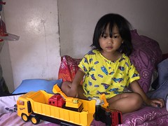 Herou and his truck. First thing in the morning (ghostgirl_Annver) Tags: asia asian boy child kid son brother family portrait truck wake up yellow morning