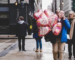 Hearts (RW Sinclair) Tags: 12 2019 56mm chicago february fuji fujifilm fujinon ilc mirrorless winter xt1 xf56f12 xf56mmf12r f12 prime telephoto street streetphotography urban people valentine valentines day heart balloon
