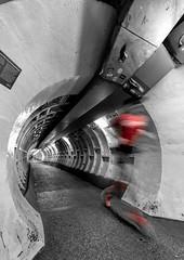 The Amazing Greenwich Foot Tunnel (Aethelweard) Tags: london england unitedkingdom gb black white history tunnel thames runner timeexposure motionblur beneath river greenwich blackandwhite