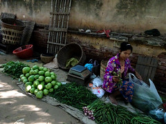At the very rear of the Mani Sithu market in Nyaung U, Myanmar (Claire Backhouse) Tags: myanmar burma bagan culture market markets street streetphotography life living people selling vendor vegetables organic fruit agriculture fresh produce farming food horticulture cultivation