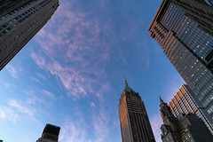 Sunset over Wall Street (wwward0) Tags: bluesky buildings cc clouds fidi financialdistrict manhattan nyc outdoor skyscrapers sunset towers wallst wwward0