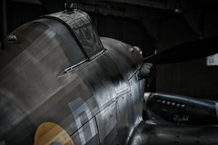 Brooding Hurricane. (Steve.T.) Tags: duxford iwmduxford hurricane hawkerhurricane aviationphotography militaryaircraft battleofbritain iconic iconicaircraft ww2aircraft ww2fighter raf d7200 nikon warbird lowlight availablelight