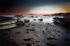 Gazing to the sea (TheStolpskott) Tags: twop landscape oceanscape seascape ef1740 soft shore beach ocean sea water longexposure cokin sunset stones rocks smooth sand moss torslanda waterscape canon 1dmk3 1dmkiii