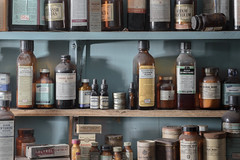 ...drugstore cowboys... (Art in Entropy) Tags: abandoned pharmacy chemicals home remedy urbex urban decay explore exploration adventure light sony sonyalpha drugs store shelf room grime creepy vintage new old stock
