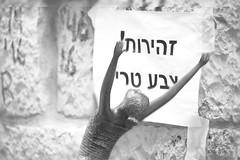 Interaction with Sculptures at Mamilla Mall B&W-3 (zeevveez) Tags: zeevveez zeevbarkan canon זאבברקן bw hebrew sculpture