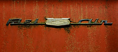 Bel Air (davidwilliamreed) Tags: old rusty crusty metal chrome auto automobile chevy chevrolet emblem rust grunge decay texture patina weathered weatherbeaten oxidized oxidation abandoned neglected forgotten oldcarcity whitega bartowcounty