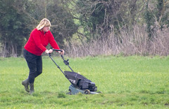 DSC_5060a (photographer695) Tags: scawby north lincolnshire lady red sweater cutting grass public right way used by dog walkers