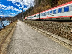 ÖBB train passing the river Inn between Kiefersfelden and Kufstein, Tyrol, Austria (UweBKK (α 77 on )) Tags: öbb österreich train zug rail railway public transport transportation path weg hike river inn kiefersfelden kufstein tyrol tirol austria europe europa iphone