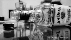 Day 77. (lizzieisdizzy) Tags: blackandwhite blackwhite black whiteandblack white whiteblack monochrome mono monotone monochromatic chromatic chroma bottle mirrorimage tabletop reflection reflections reflective reflect reflecting refection alchohol glass empty vessel container cap lid metal label whiskey bourbon american drink tasty
