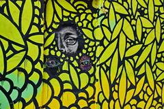 The voyeur. (gerard eder) Tags: world travel reise viajes europa europe españa spain spanien graffiti mural street streetlife streetart art arte valencia elcarmen city ciudades cityscape cityview outdoor oldcity yellow