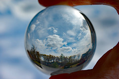 Lensball Sky. (dccradio) Tags: lumberton nc northcarolina robesoncounty outside outdoor outdoors lensball lensballphotography tensphy sky clouds bluesky march spring springtime nature natural landscape hand finger thumb nikon d40 dslr crystalball glassball glass circle round saturday weekend saturdayafternoon afternoon goodafternoon dumpster trashbin redtruck truck pickup pickuptruck tree trees woods wooded forest parking parkinglot paved pavement