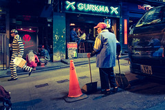 Hmm? (Goran Bangkok) Tags: cleaner hongkong street sweeper man night prisoner inmate jail happyplanet asiafavorites fuji fujifilm