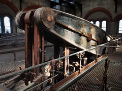 47-ton rotative steam engine rocking beam - Crossness sewage pumping station, London SE2.. (edk7) Tags: olympuspenliteepl5 edk7 2016 uk england london londonse2 londonboroughofbexley erithmarshes abbeywood crossnesssewagetreatmentworks thameswater thecrossnessenginestrust crossnesspumpingstation 1865 formermetropolitanboardofworkssouthernoutfallworkssewagepumpingstation sirjosephbazalgette charleshenrydriver southernoutfallsewer gradeilisted victorian romanesque industrial architecture building oldstructure brick stone steel beamenginehouse ornamentalironwork iron tread pistonrod castironbeam 47tonrotativesteamenginerockingbeam
