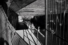 (a.pierre4840) Tags: olympus om2n zuiko 24mm f28 35mmfilm kodak kodaktrix trix bw blackandwhite monochrome noiretblanc shadows lines canal bridge path urban decay london england