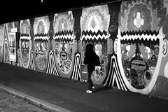 Along masks (pascalcolin1) Tags: paris13 femme woman nuit night lumière light mur wall masques masks photoderue streetview urbanarte noiretblanc blackandwhite photopascalcolin 50mm canon50mm canon