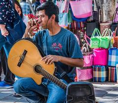 2018 - Mexico - Oaxaca - Zocalo 6 String (Ted's photos - Returns late Feb) Tags: 2018 cropped mexico nikon nikond750 nikonfx oaxaca tedmcgrath tedsphotos tedsphotosmexico vignetting guitar guitarplayer 6stringguitar musician denim denimjeans male boy man dents teeth zocalo oaxacazocalo entertainer microphone