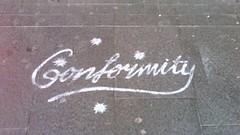 Anglų lietuvių žodynas. Žodis conformity reiškia n 1) atitikimas; 2) subordinacija; in conformity (with) sutinkamai (su) lietuviškai.