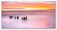 ABC_5319 (Lynne J Photography) Tags: northumberland coast seascapes sunrise water longexposure groynes outfallpipe clouds mono blackwhite pier cambois blyth rocks seatonsluice lighthouse pastel colors dawn light