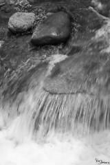 water (Kusi Seminario) Tags: agua water stream canal river acequia waterstream bw blancoynegro blackandwhite longexposition