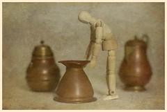 Still Life (N.the.Kudzu) Tags: tabletop stilllife wooden mannequin copper pots canondslr zenitar50mmf12 ringlight photoscape texture frame