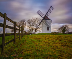how time flies by (Wizard CG) Tags: ashton windmill somerset england english heritage grade ii listed building 18th century sunset sky chapel allerton epl7 trees warm beautiful earth outdoor grass plant wedmore countryside green blue four sails fence rickety bank