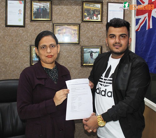 Ms. Parwinder Kaur (Director of West Highlander) handing over Australia Graduate Dependent Visa (subclass 485) to Sumit Sharma