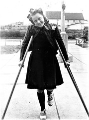 1940s Girl on crutches (jackcast2015) Tags: handicapped disabledwoman crippledwoman paralysed poliogirl polio poliomyelitis poliowoman crutches