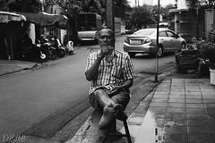 Unsure (D. R. Hill Photography) Tags: bangkok thailand thai asia southeastasia urban city street streetphotography man person portrait life film analog analogue grain 135 35mmfilm contax contaxg1 g1 carlzeissplanar45mmf2 zeiss planar 45mm primelens fixedfocallength jch jchstreetpan400 streetpan japancamerahunter blackandwhite monochrome