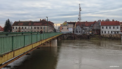 Entering the city through a steel bridge (malioli) Tags: bridge river water kupa city town building tower karlovac croatia hrvatska europe canon