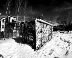 Graffitti Crate Plateau Mont-Royal (Montreal) (MassiveKontent) Tags: winter snow street contrast noiretblanc blackwhite blancoynegro montreal bw city monochrome urban blackandwhite streetphoto montréal quebec canada streetphotography bwphotography streetshot absoluteblackandwhite frozen mono cold montroyal plateau gopro art streetart park graffiti
